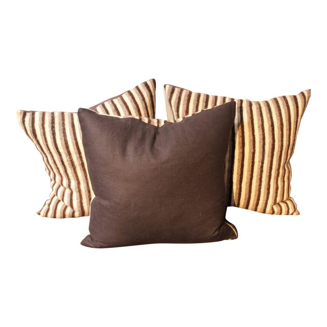 Set of three handwoven saddle blanket pillows. The colors are brown and cream. The backing is in a brown cotton linen....