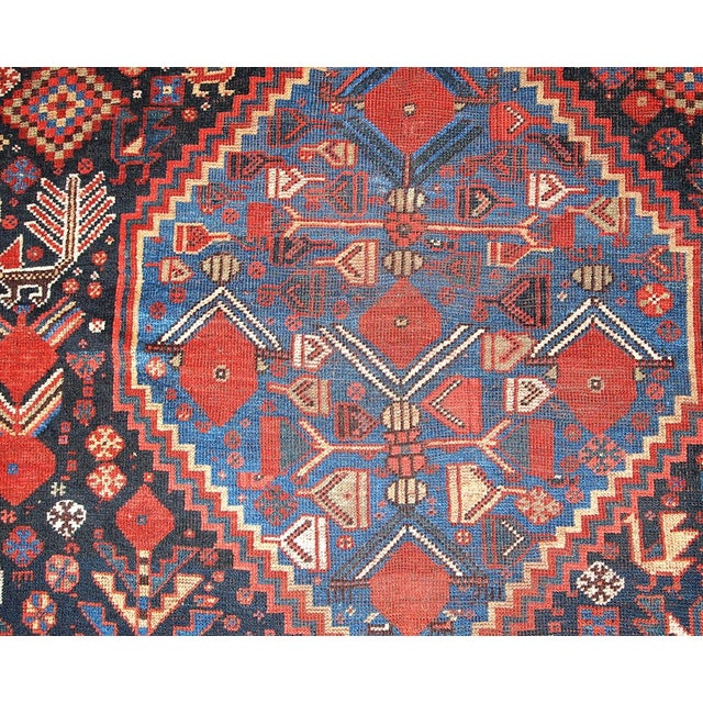Islamic 1880s Hand Made Antique Persian Khamseh Rug - 6' X 9' For Sale - Image 3 of 10