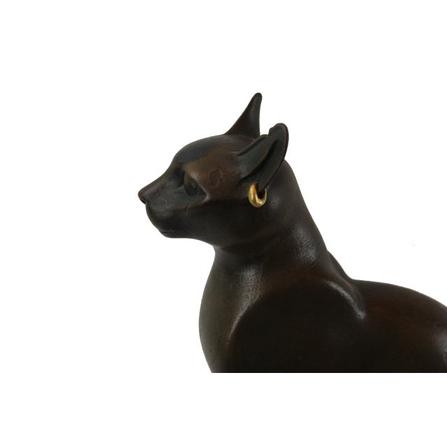Vintage Bronze Egyptian Cat Sculpture Bonded bronze Reproduction, which is based on an Egyptian sculpture of the Ptolemaic...