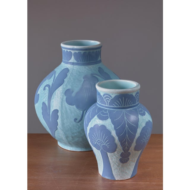 A pair of blue ceramic 'Sgraffito' vases, decorated with a floral motif, by Josef Ekberg for Gustavsberg. The measurements...