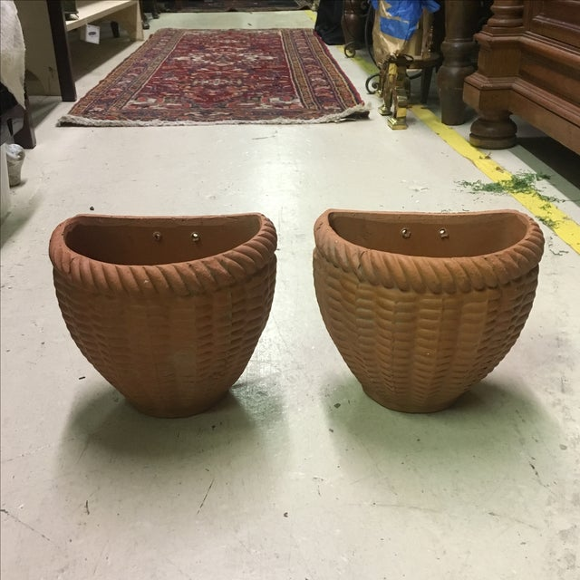 Pair of Italian terra cotta wall planters with basket weave motif.