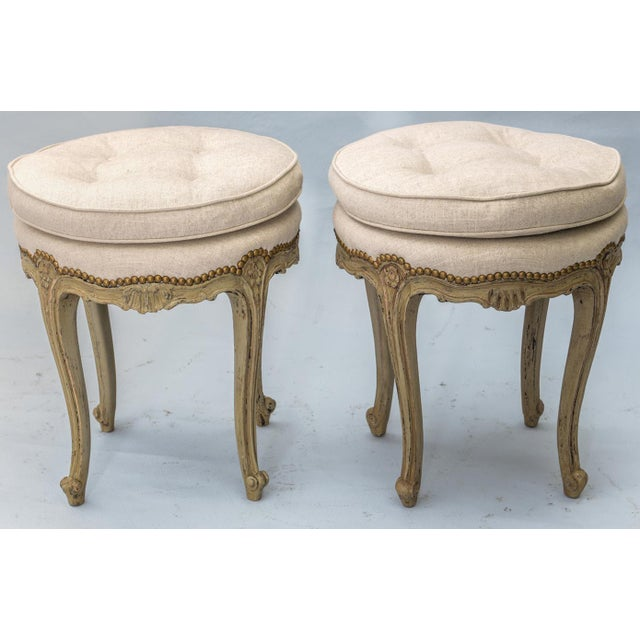 Pair of stools in Louis XV style, each tufted round top semi attached cushion on matching deck with nailheads, painted...