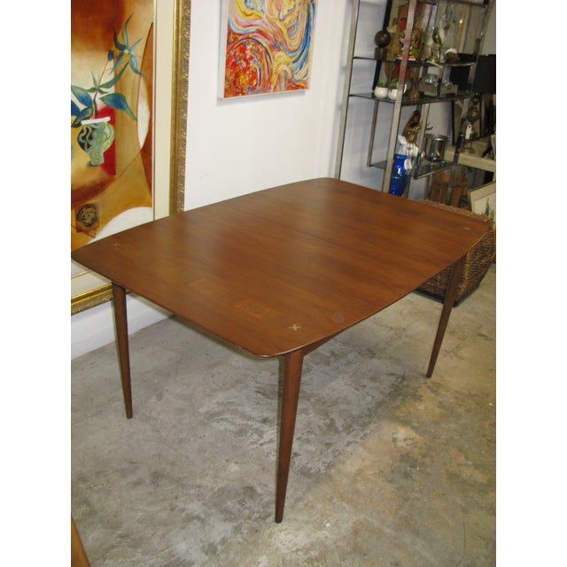 Wonderful table. American of Martinsville walnut dining table. Star inlay mid century 1 leaf. 40 wide 29.5 high 60 long/72...