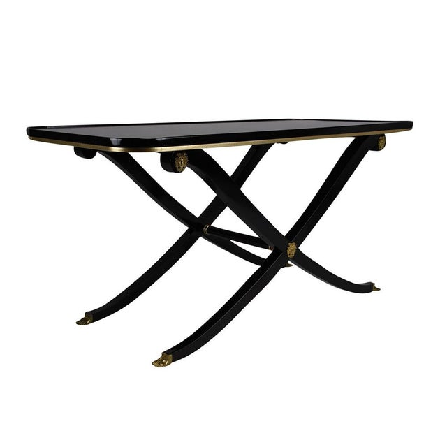 This 1950's Vintage French Empire-style coffee table is made of mahogany wood that has been finished in a rich black color...