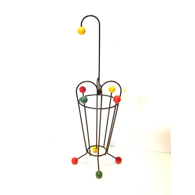A very cool and unique umbrella stand, circa 1950s made in France iron and color painted decorative wood balls, nice...