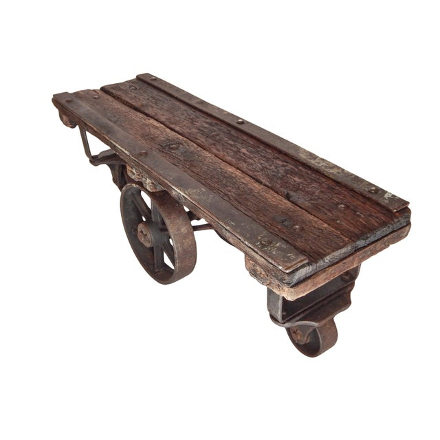 Wonderful iron and wood trolley table.