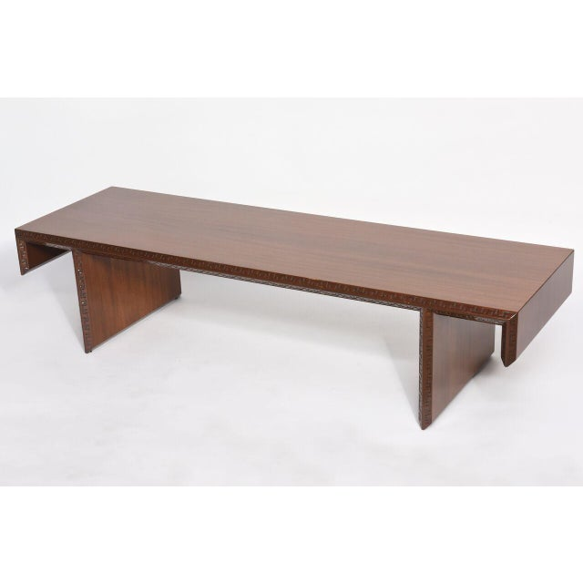 The rectangular top with modified Greek key edge detail on plank legs with similar motif heritage Henredon designed as a...