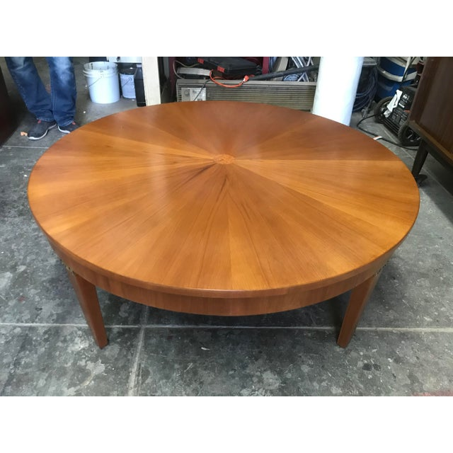 Gorgeous Cherry Wood coffee table by Baker. Sunburst top with veneer strips and center burl wood accent, lovely triangular...
