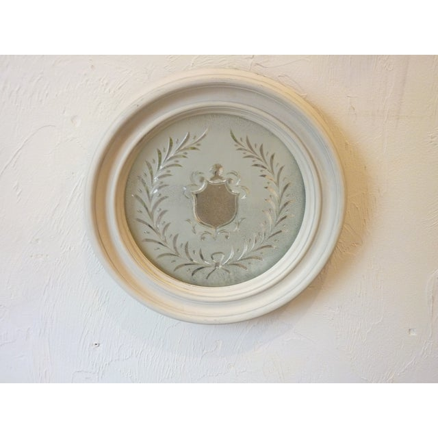 20th Century round accent mirror with etched design of a heraldic motif, ready to hang.