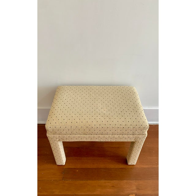 Beautiful and elegant Parsons or Parsons style bench/stool. Upholstered with black embroidered polka dots on beige fabric....