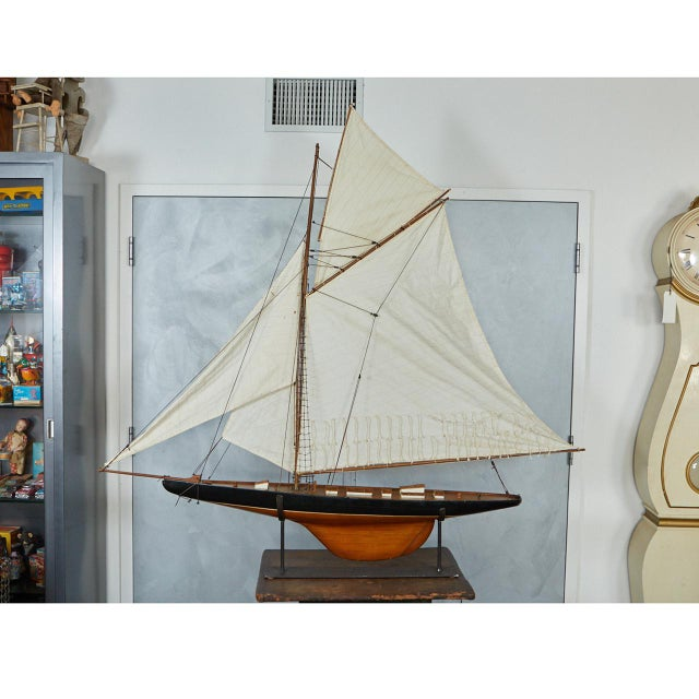This large model sailboat is an impressive piece of craftsmanship. It has four sales and multiple cabins. It sits on a...