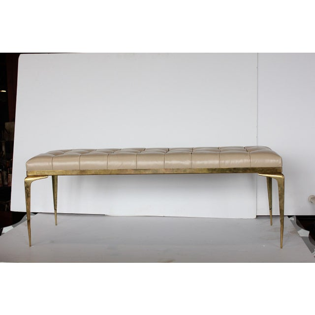 Mid century Italian brass bench with leather upholstery.