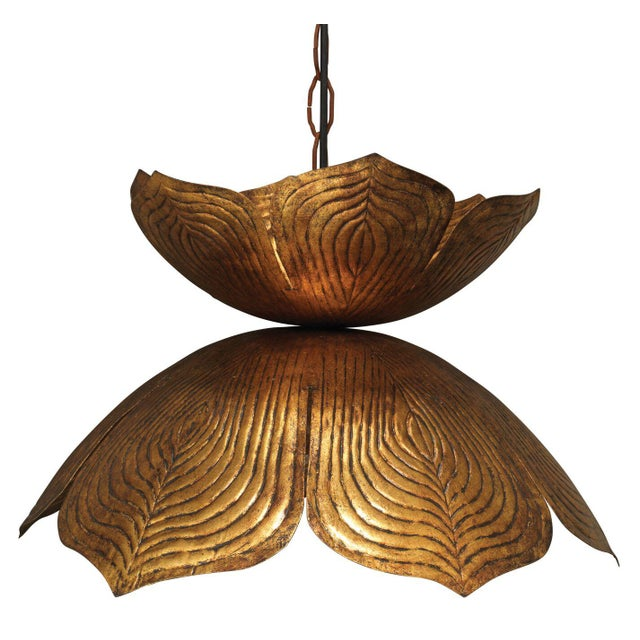 Shimmering and grand, this pendant light features a blooming lotus design that creates a stunning statement. Made of metal...