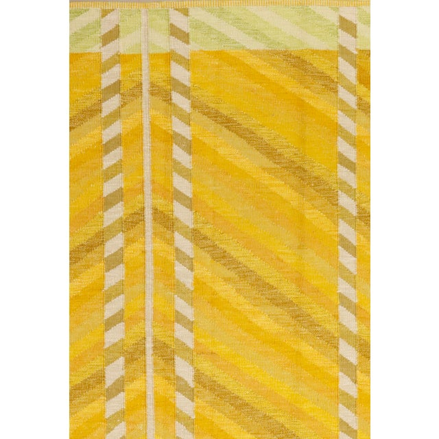 A modern hand knotted Swedish design wool rug. Of vivid saffron colors. A sturdy, durable flatweave floor covering.
