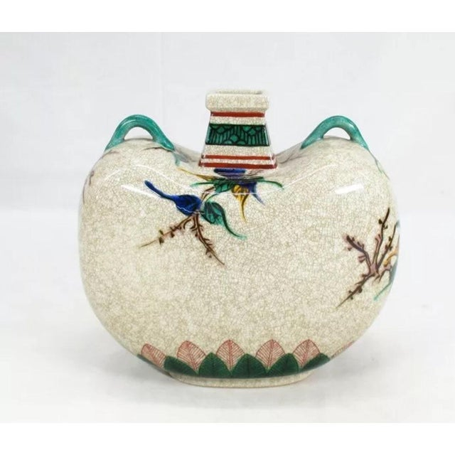 Beautiful traditional Kutani vase with an overall design of flora and fauna in brilliant colors. Short square mouth on a...