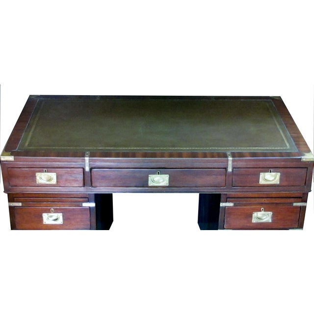 the rectangular top with leather insert above a long center drawer and two side cabinets each with 4 drawers; all with...