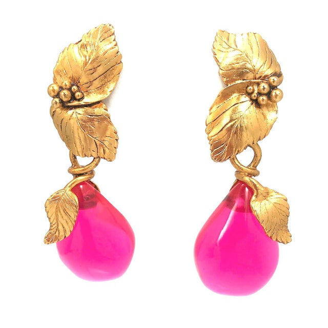 Vintage Emanuel Ungaro, Paris drop earrings. Cast gold leaves hold large translucent hot pink pear shapes. From top to...