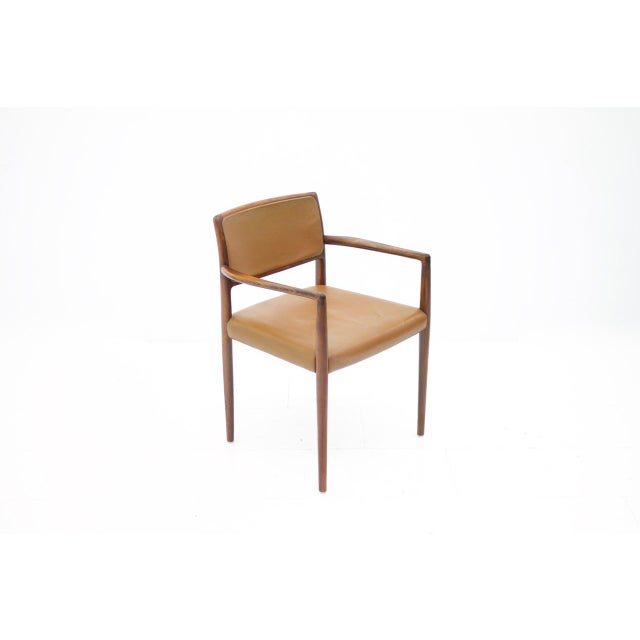 Scandinavian Armchairs in Rosewood and brown Leather. Two Chairs are available. Good original Condition.