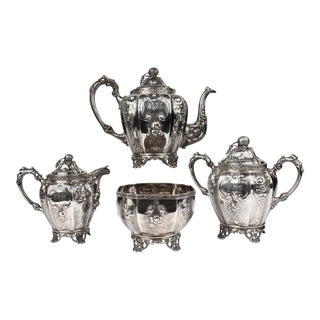 19th Century Four-Piece Wood and Hughes Repousse New York Coin Silver Tea Set - Set of 4 For Sale