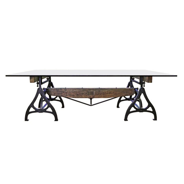 Industrial Machine Age wood, steel and cast iron conference table. Glass shown measures 96″ x 56 1/2″ and is 30 1/8″ in...
