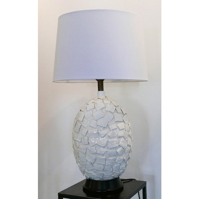 This is a unique white ceramic lamp with applied squares. It is very textural and has multiple layers. New lampshade and...