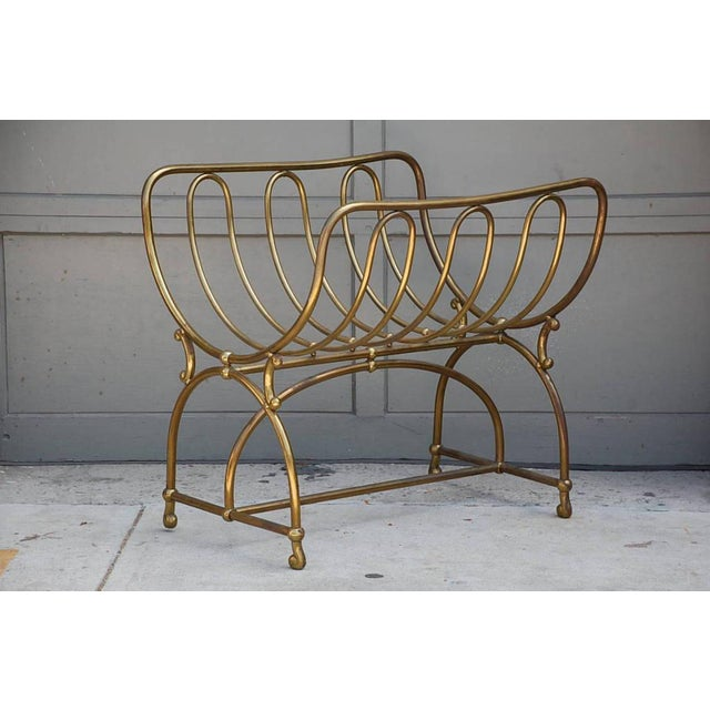 Unique solid brass fireplace wood rack by Siegel Paris. Signed on plaque.