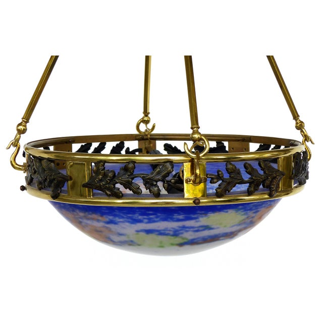 Offered for sale is a French Art Deco bronze ceiling fixture with a fitted blown glass bowl in the manner of Muller Fres...