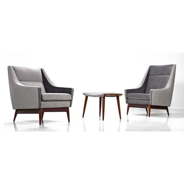 Absolutely outstanding set of mid century modern arm chairs with matching foot stool. His and hers set, circa 1950s,...
