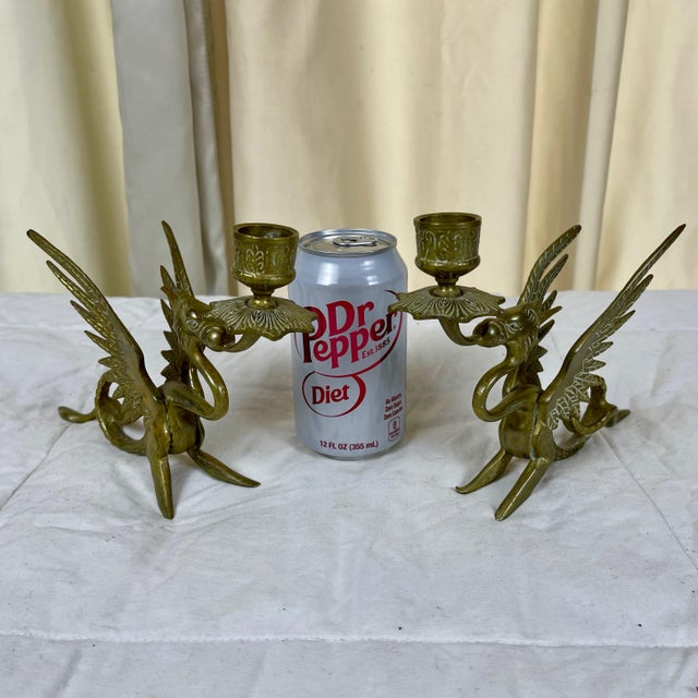 This pair of brass candle holders/sticks are in very good original found condition with wear consistent with use and age....