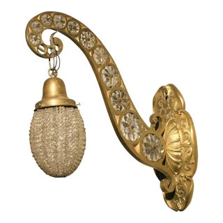 Hollywood Regency Brass and Crystal Beaded Sconce For Sale