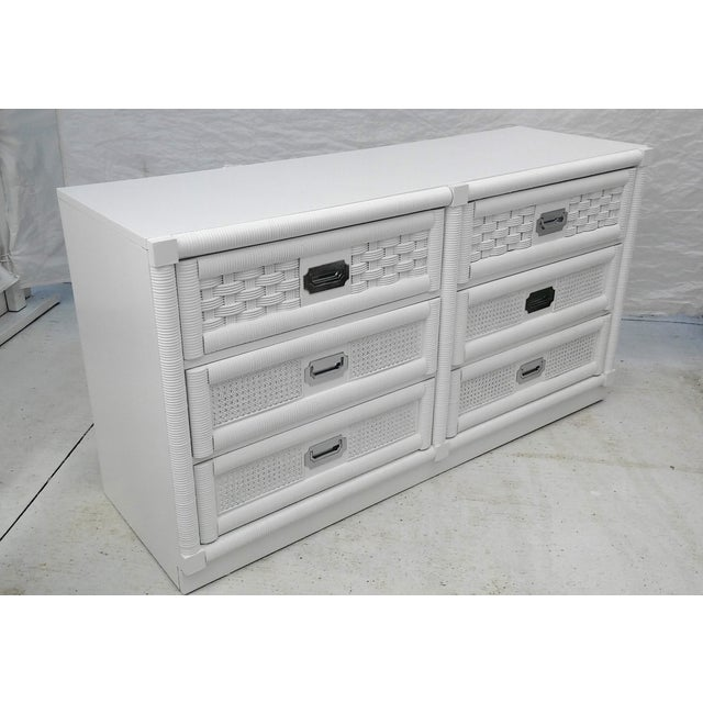 This beautifully refinished campaign style dresser features an elegant white lacquered mirror finish with six original...