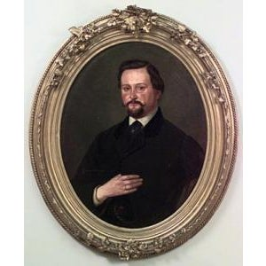 Pair of American Victorian style gilt framed oval oil painting portraits of man with mustache and lady in black lace