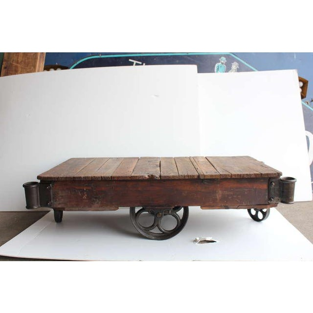 Vintage American industrial cart/coffee table. Newly refinished. We have over 20 carts available.