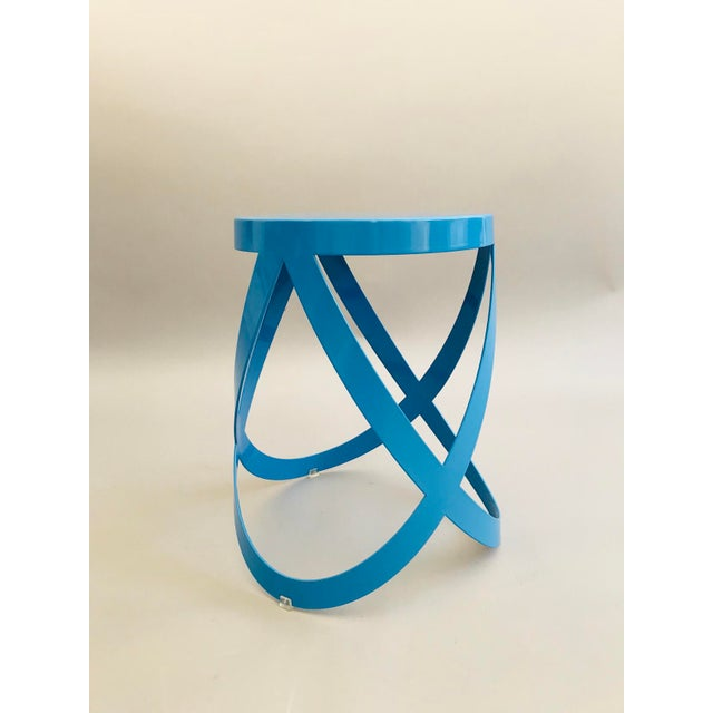 Ribbon Stool by Design Group, Nendo, 2007 for Cappellini. Metal laser-cut plate, in blue lacquered paint.