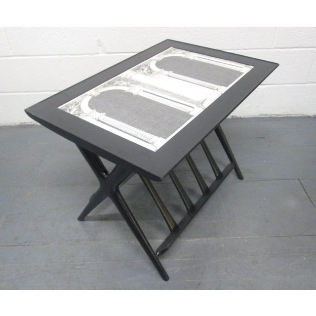 Italian Modern Side Table Style of Piero Fornasetti. Table is black lacquered. Has a Fornasetti label underneath.