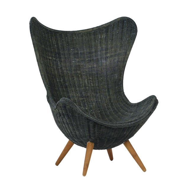 Black stained hand woven wicker egg shaped easy chair. Modern design with classic materials and teak stained wood legs.