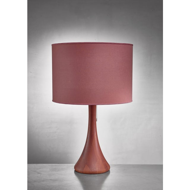 A wooden, conical table lamp by Dyrlund, Denmark. The measurements stated are of the lamp without a shade.