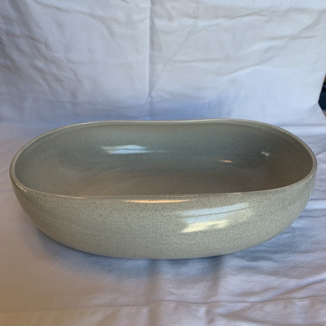 Vintage Russel Wright Steubenville bowl in a lovely oyster gray color. A great minimalist, mid-century addition to the...
