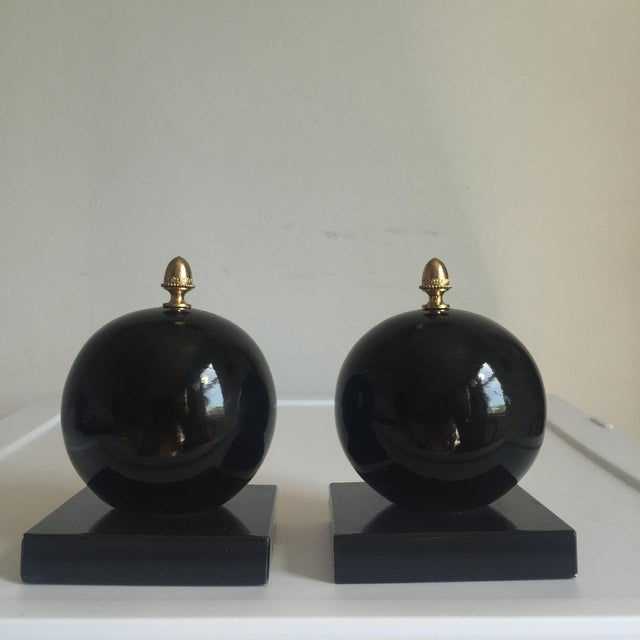 Fabulous pair of vintage alabaster orb bookends with brass detail. These are sure to make a statement however you choose...