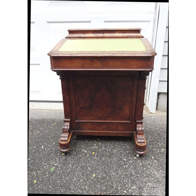A beautiful 19th Century English Walnut Davenport Desk. The slant top lifts to reveal 2 drawers and 2 faux drawers. The...