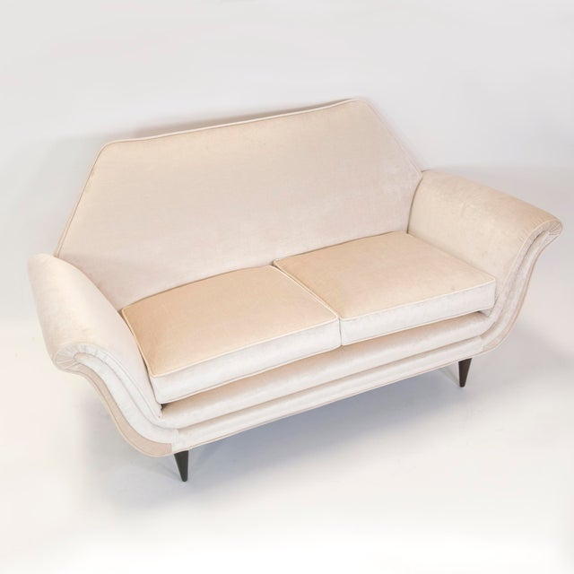 Fantastic sculptural mid-century modern Italian love seat. Restored and reupholstered.