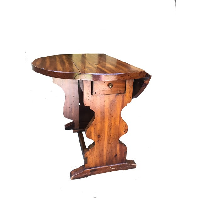 Absolutely charming pine butterfly drop leaf accent table. Manufactured by American of Martinsville. This rare little gem...