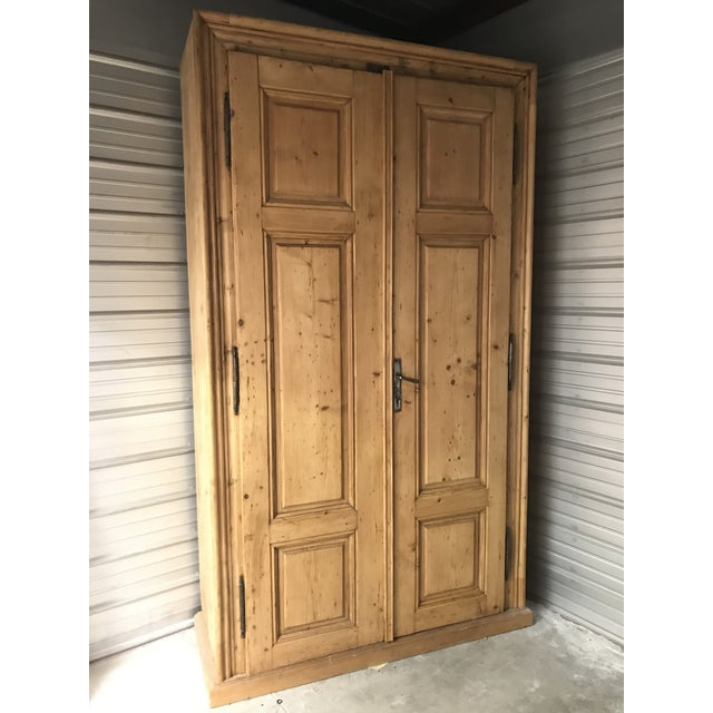 Handmade German, solid pine, 9ft tall armoire. This late 1800's custom piece is in excellent condition and has two...