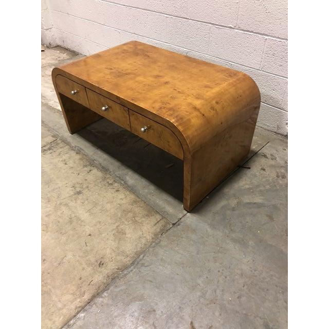 Solid Burlwood Vintage Art Deco Coffee table. Modern and sleek. 3 functional drawers on each side. Very Unique piece.