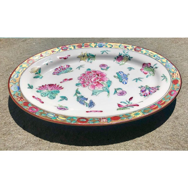 Lovely Hong Kong export platter, decorated with peonies and flowers, gilt rim. Circa 1960s.