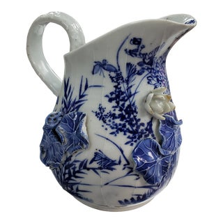Mid 19th Century English Flow Blue Porcelain Pitcher With Applied Flower/Lilies For Sale