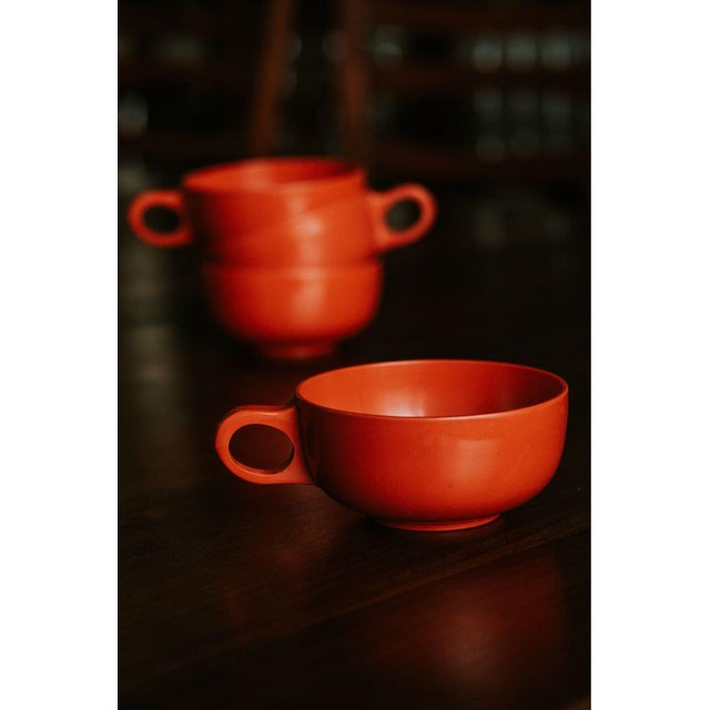 Offered is this darling set of four vibrant orange-red cups. Perfect for double or triple espressos and macchiatos.