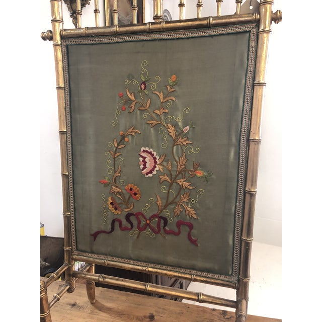 Embroidered French fire screen with asymmetrical gilt bamboo frame.