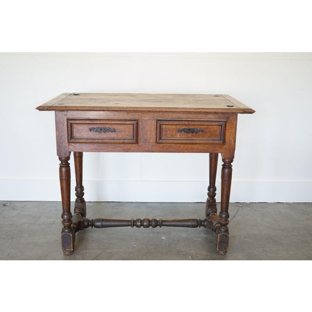 What you're seeing here is a late 17th century French Louis XIII Side Table complete with two drawers, turned legs, and...