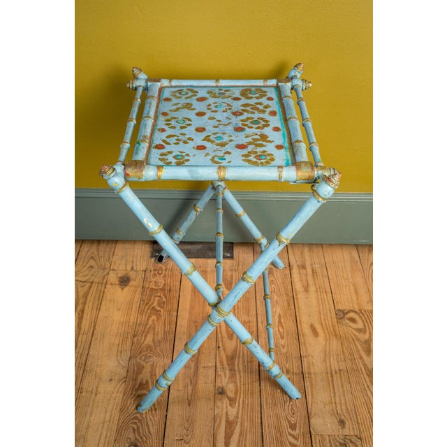 Antique painted tray table from Belgium. Tray raised upon hand-carved faux bamboo legs and stretcher. Serves as a...